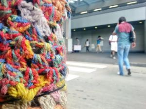 Walking down the station and I saw this colourful crochet covering the sign post pole. Creative use of legal vandalism. Photo by: Tina Tek